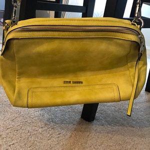 Yellow Steve Madden bag with long shoulder strap